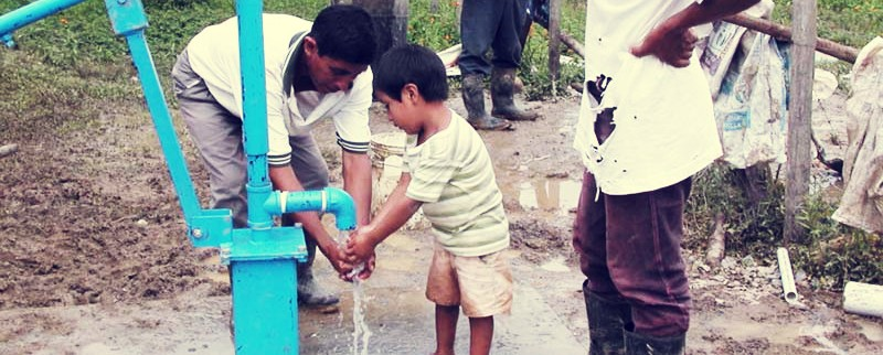 child-pumping-water